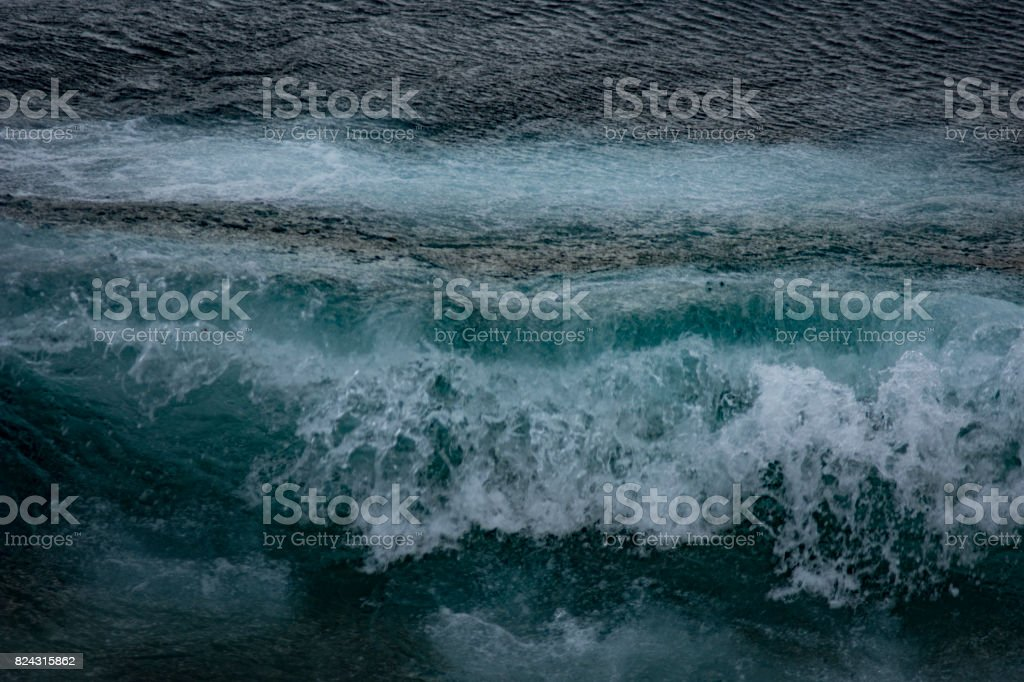 Wave in blue sea stock photo