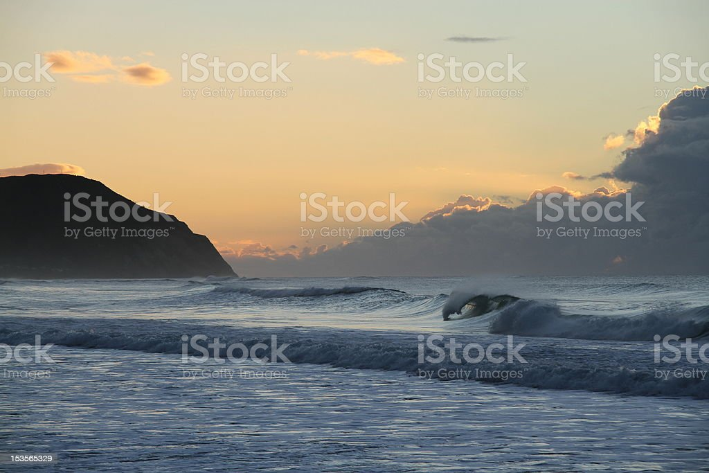 Wave in sea at sunrise stock photo