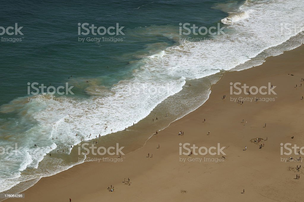 Wave ocean diagonal with unrecognisable people stock photo