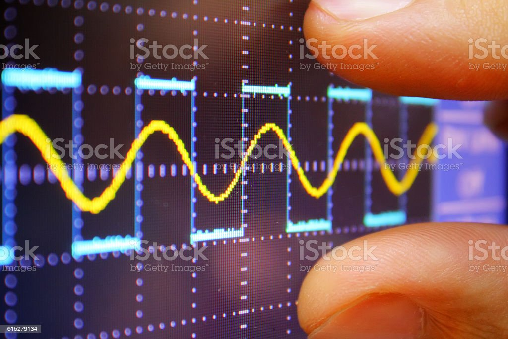 wave on oscilloscope stock photo