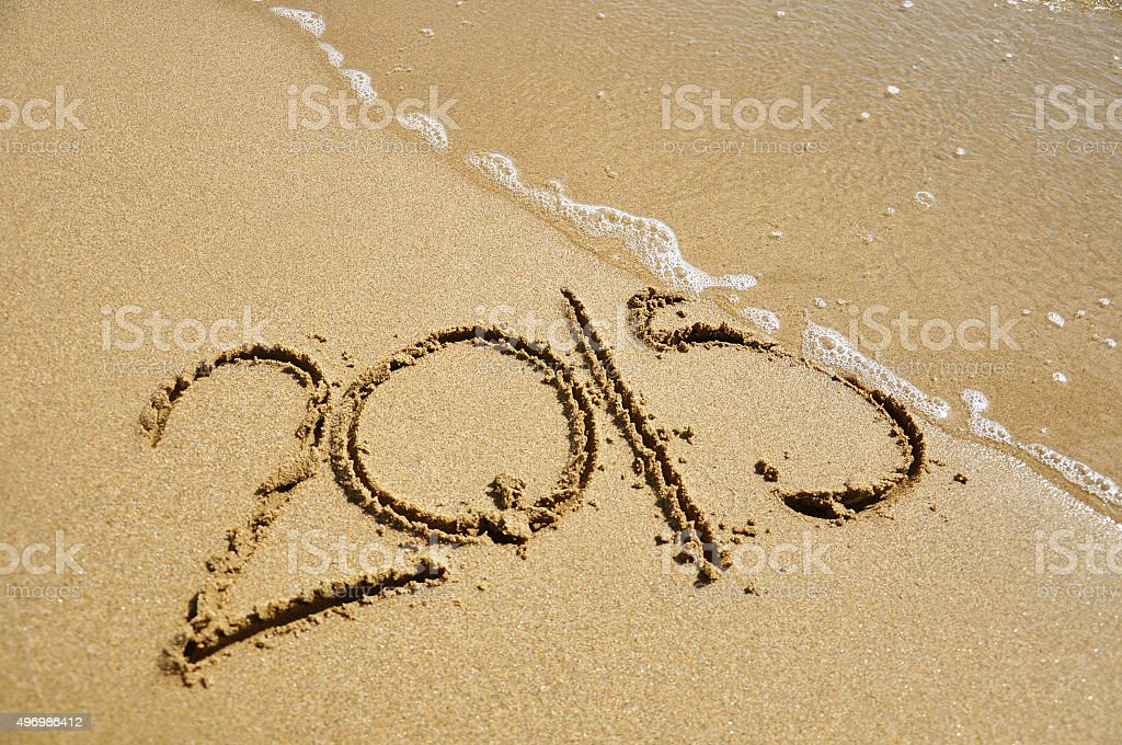 Wave removing the year 2015 stock photo