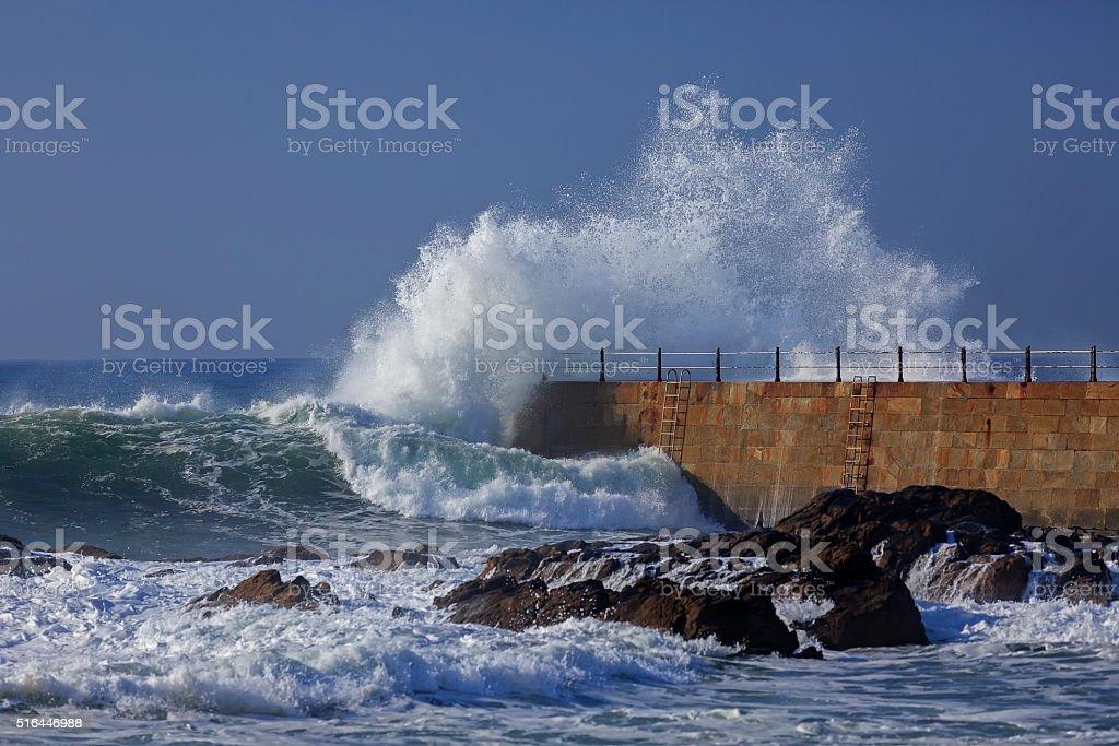Wave splash near the pier of lighthouse, Porto, Portugal stock photo