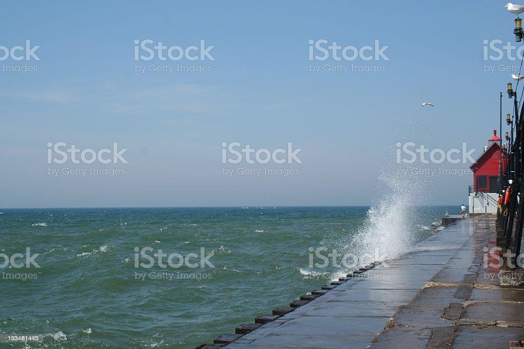 Wave Splash on Grand Haven Pier royalty-free stock photo