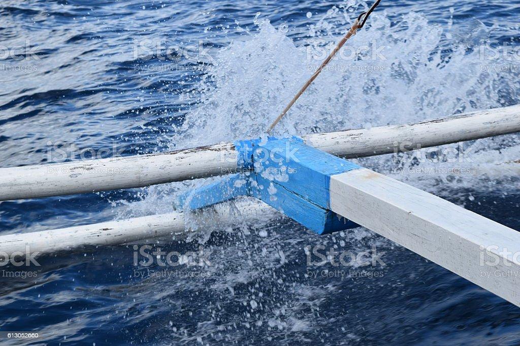 Wave splashing boat edge. stock photo