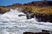 wave splashing on rock