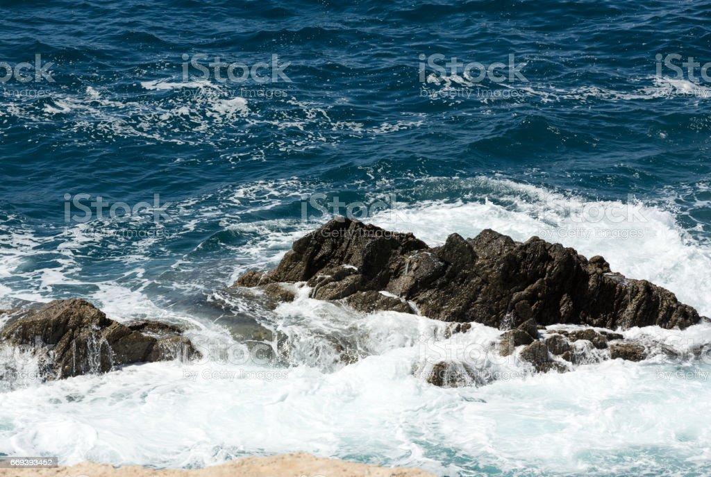 Wave splashing over a rock on Caleta Negra beach in Ajuy  on Fuerteventura. Canary Island, Spain stock photo