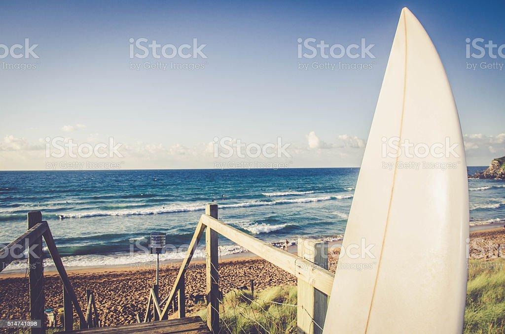 Wave Surfboard on the Beach stock photo