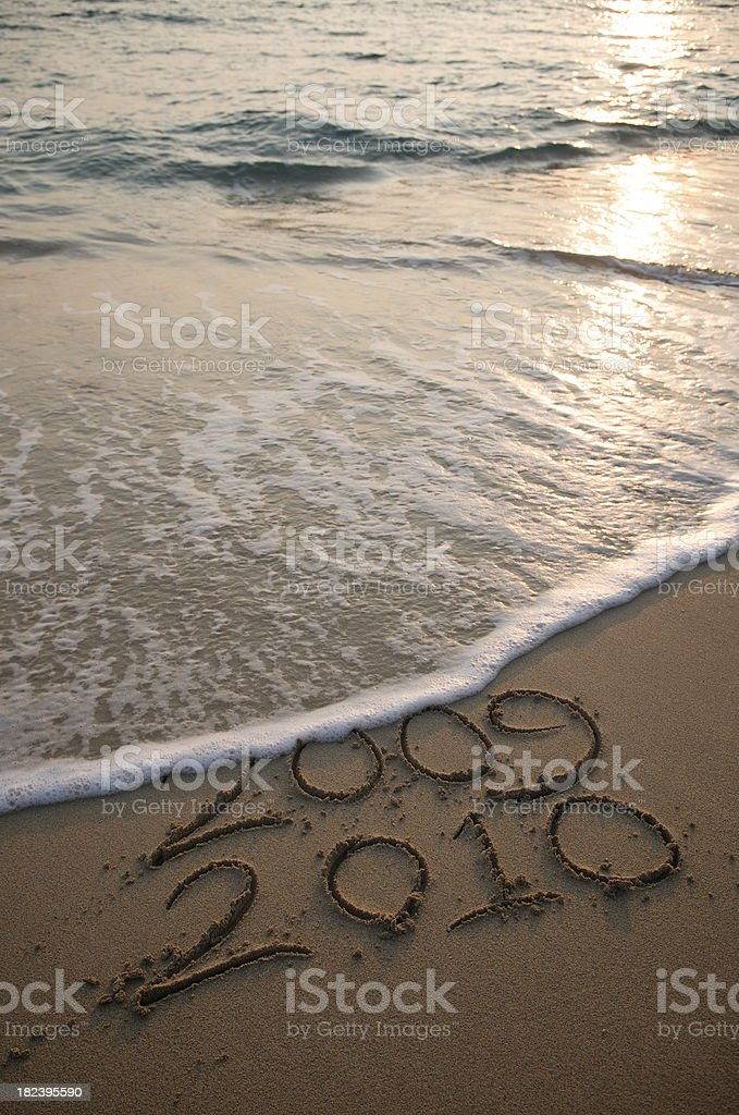 Wave Washes 2009 Leaving 2010 on Beach stock photo