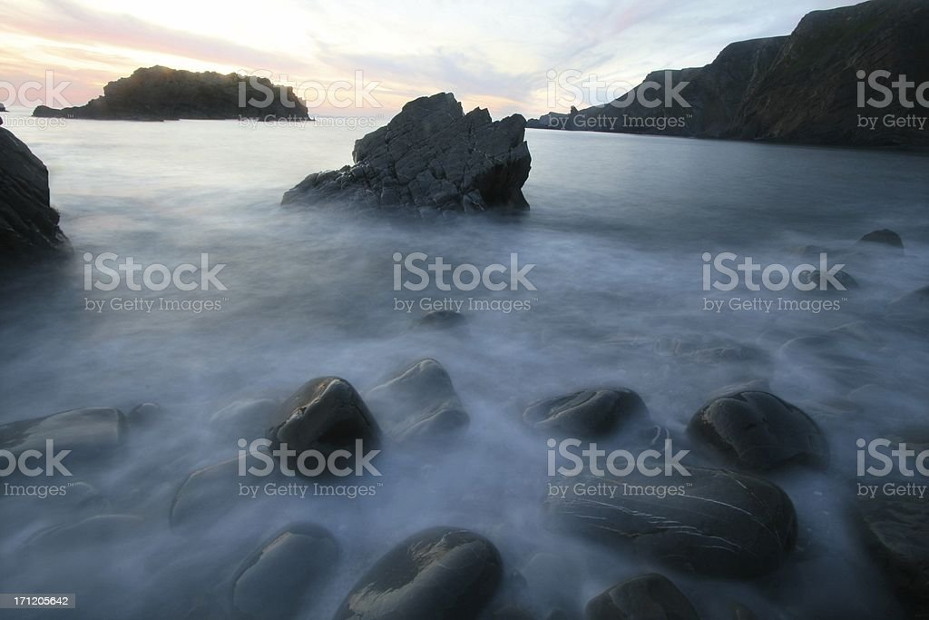 A wave washes in royalty-free stock photo
