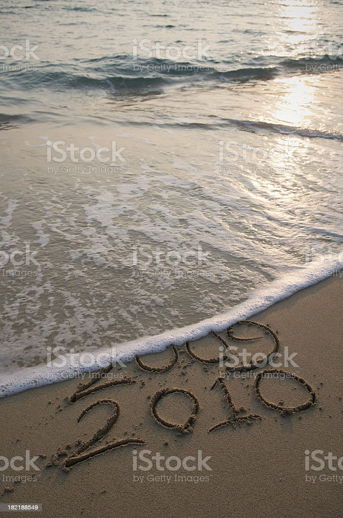 Wave Wipes Out 2009 Leaving 2010 On Beach stock photo