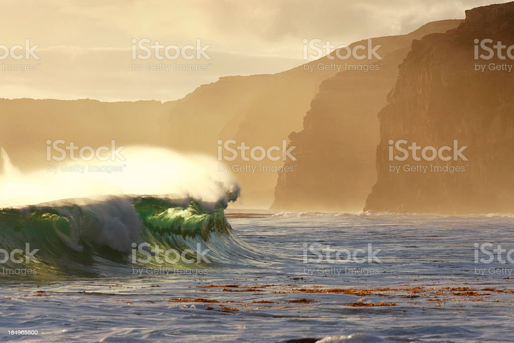 Wave with Towering Cliffs stock photo