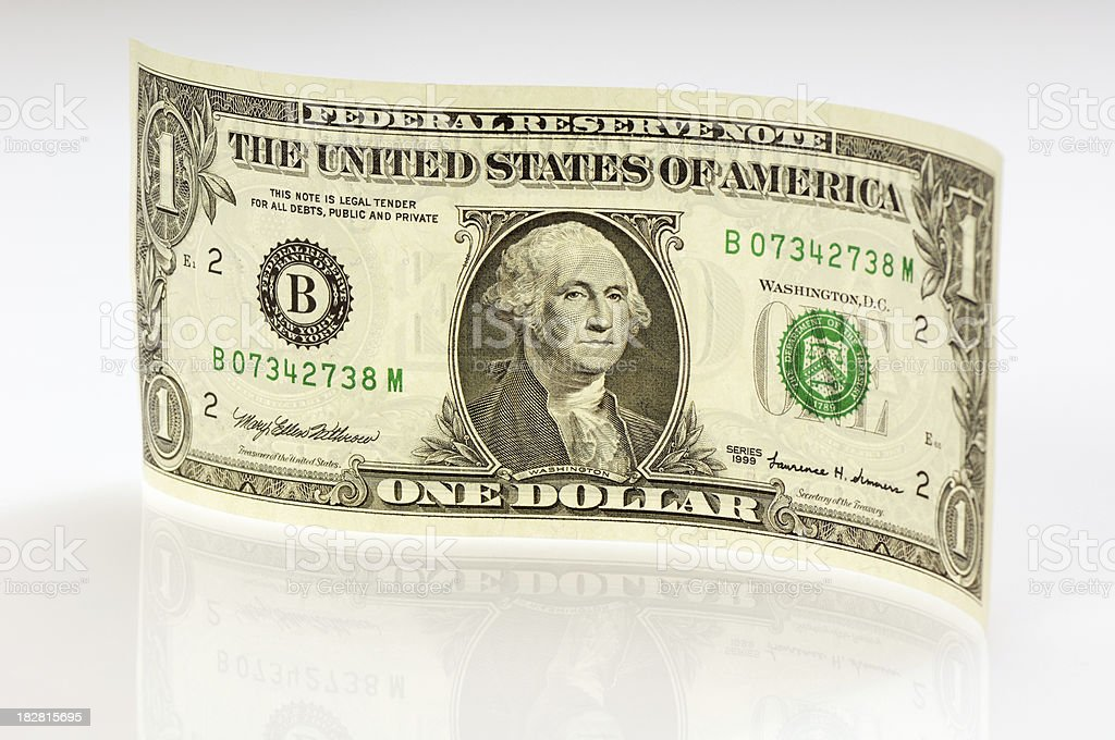Waved one dollar bill with reflection stock photo