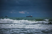 Waves and cargo ship in the ocean