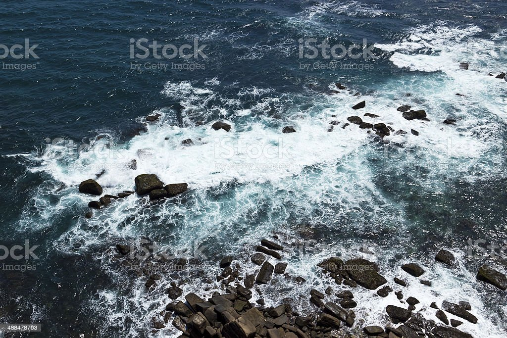 Waves and rocks on the Ocean from above royalty-free stock photo