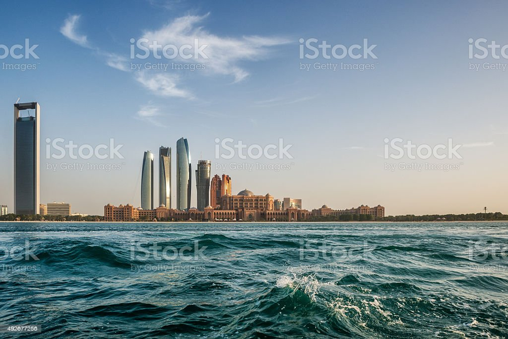 Waves and skyscrapers in Abu Dhabi stock photo