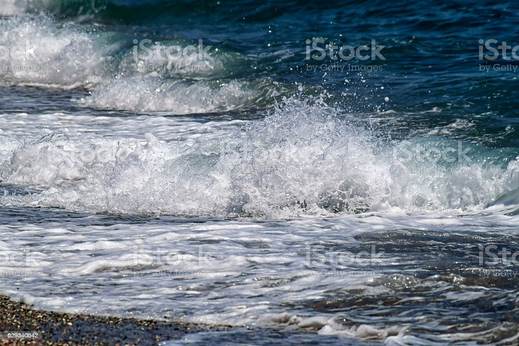 Waves at te beach stock photo