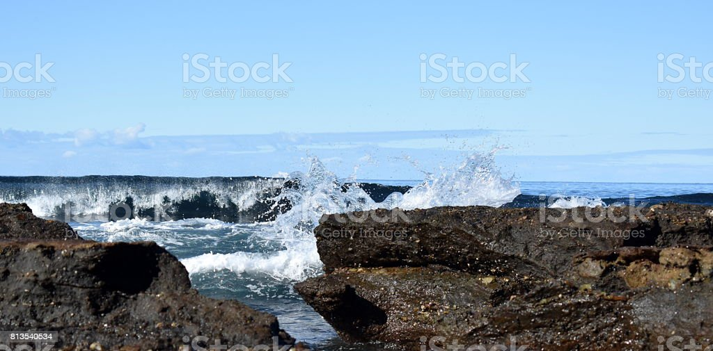 Waves at the beach stock photo
