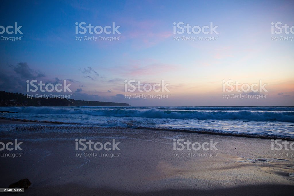 Waves at the sunset on Dreamland beach, Bali island. stock photo