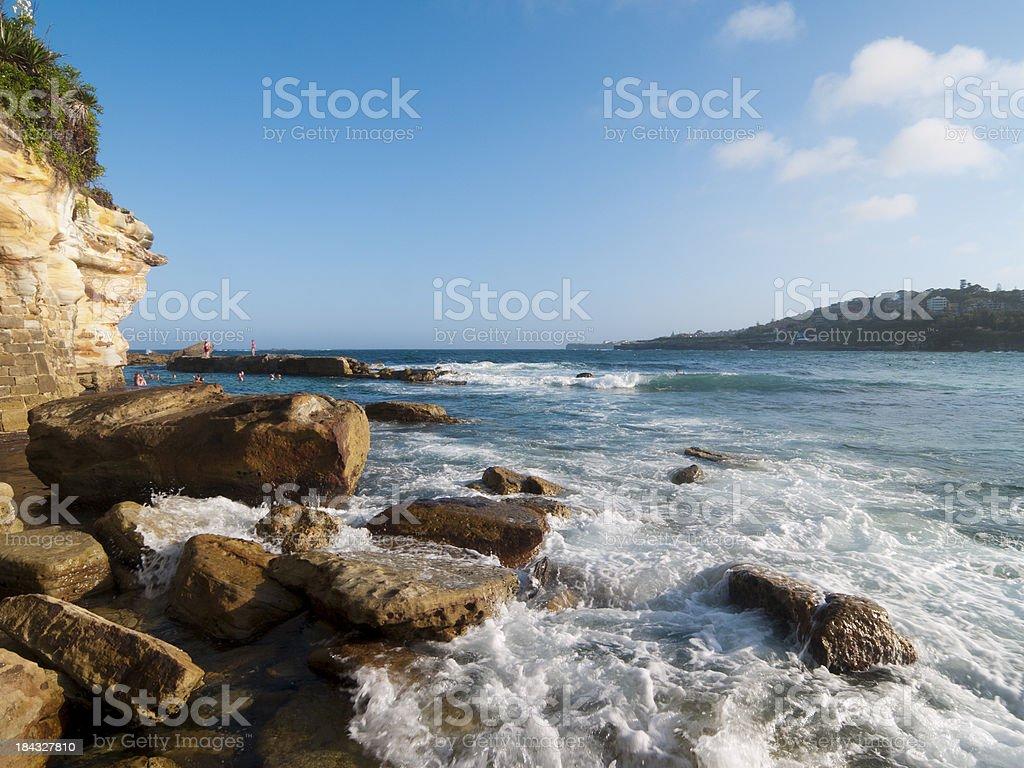 Waves break in Coogee stock photo