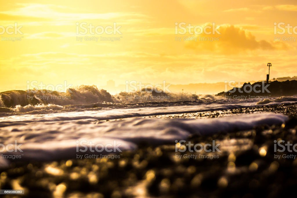 Waves Breaking Along the Shore at Hengistbury Head in Dorset stock photo