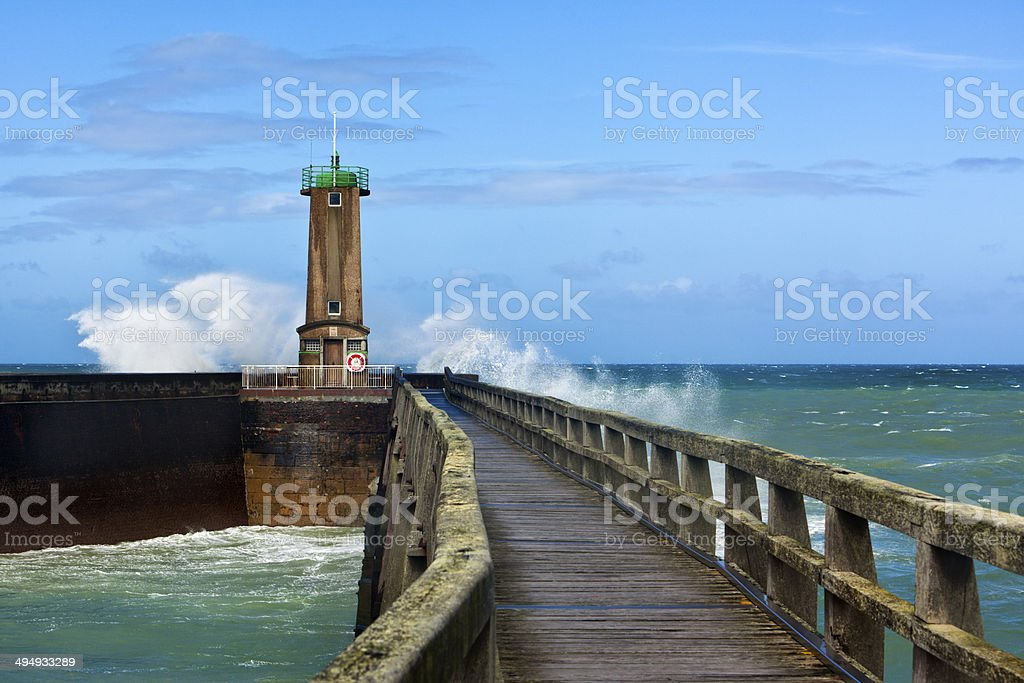 Waves breaking at lighthouse, Fecamp, France stock photo