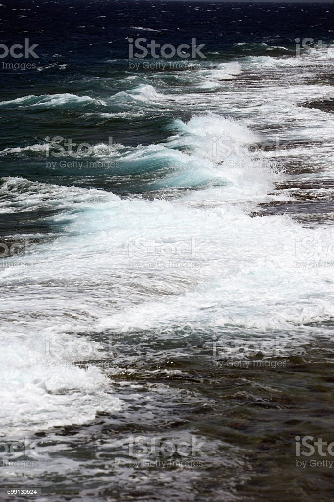 Waves breaking on a reef stock photo