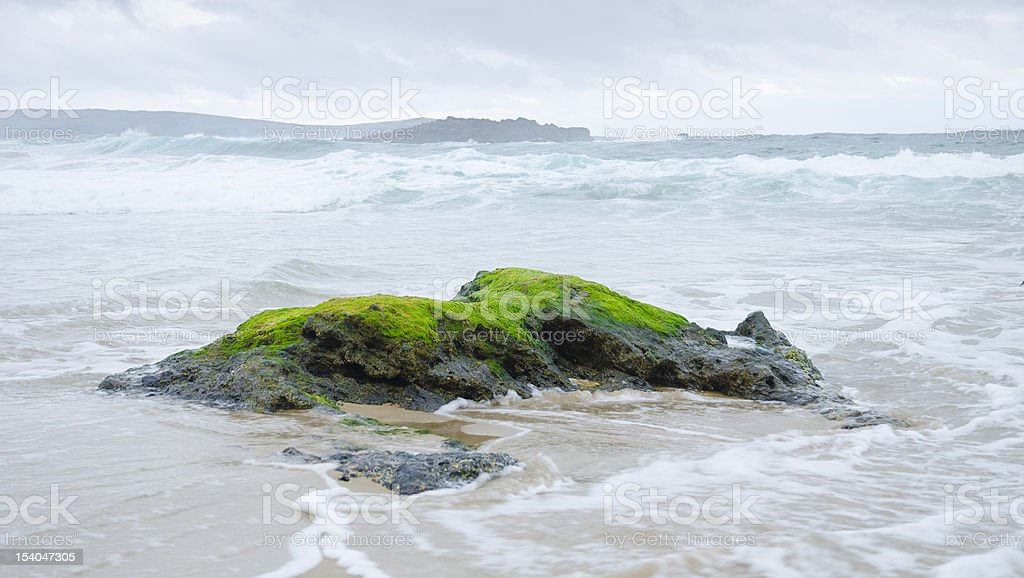Waves breaking on a rock, stormy day royalty-free stock photo