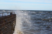 Waves Breaking On Harbor Wall at Arbroath, Scotland