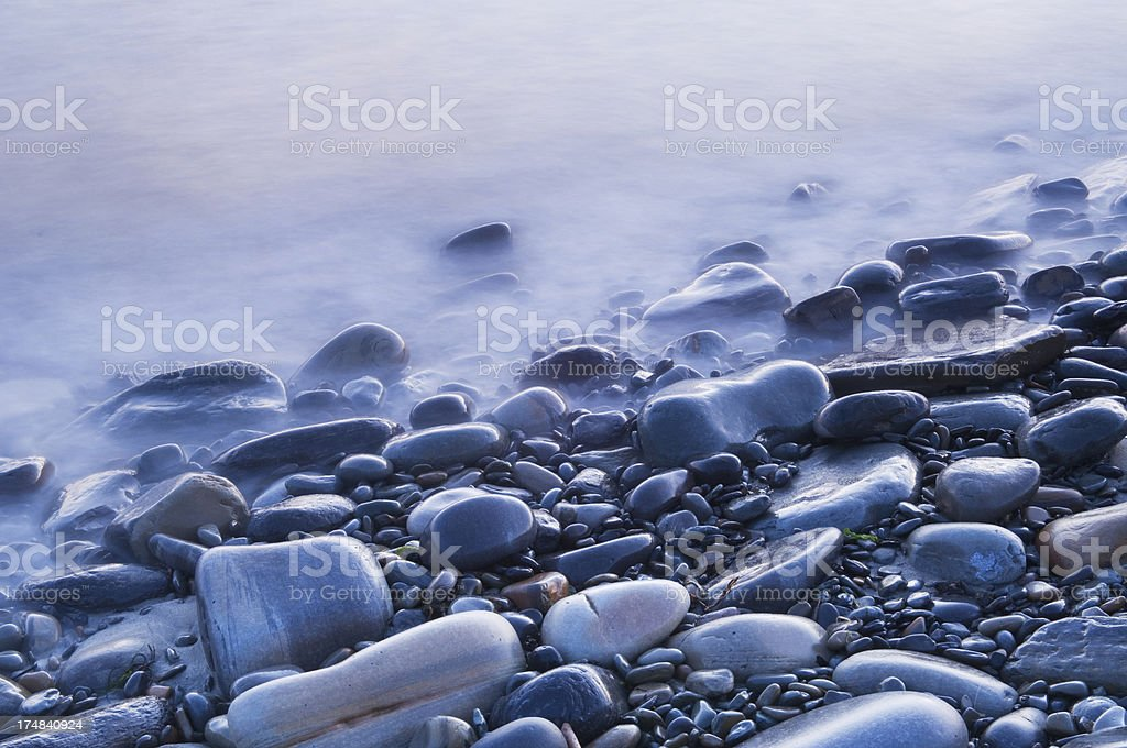 Waves breaking on pebbles royalty-free stock photo