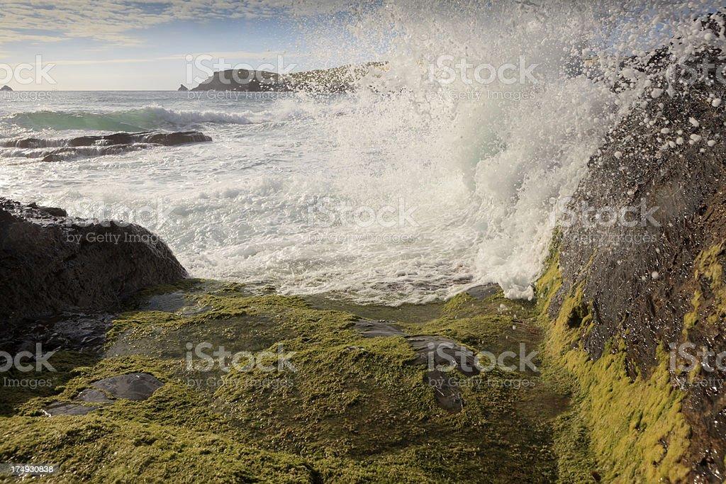 waves breaking on the Cornish coast stock photo