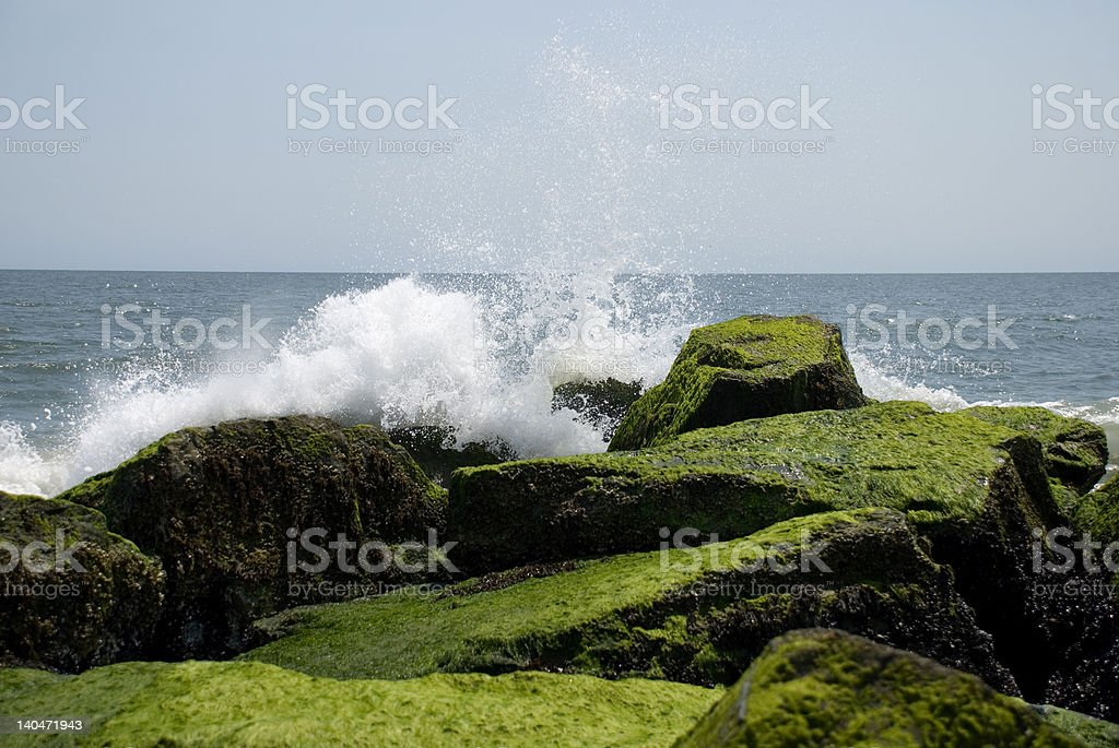 Waves Breaking on Weathered Rocks royalty-free stock photo