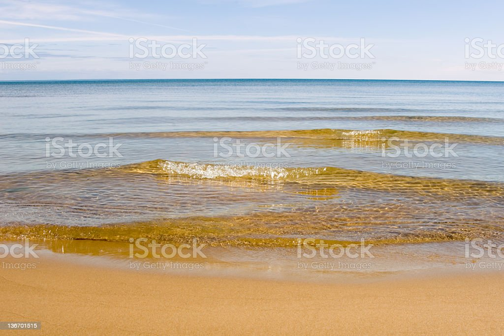 Waves Breaking onto Beach, Water's Edge Close Up royalty-free stock photo