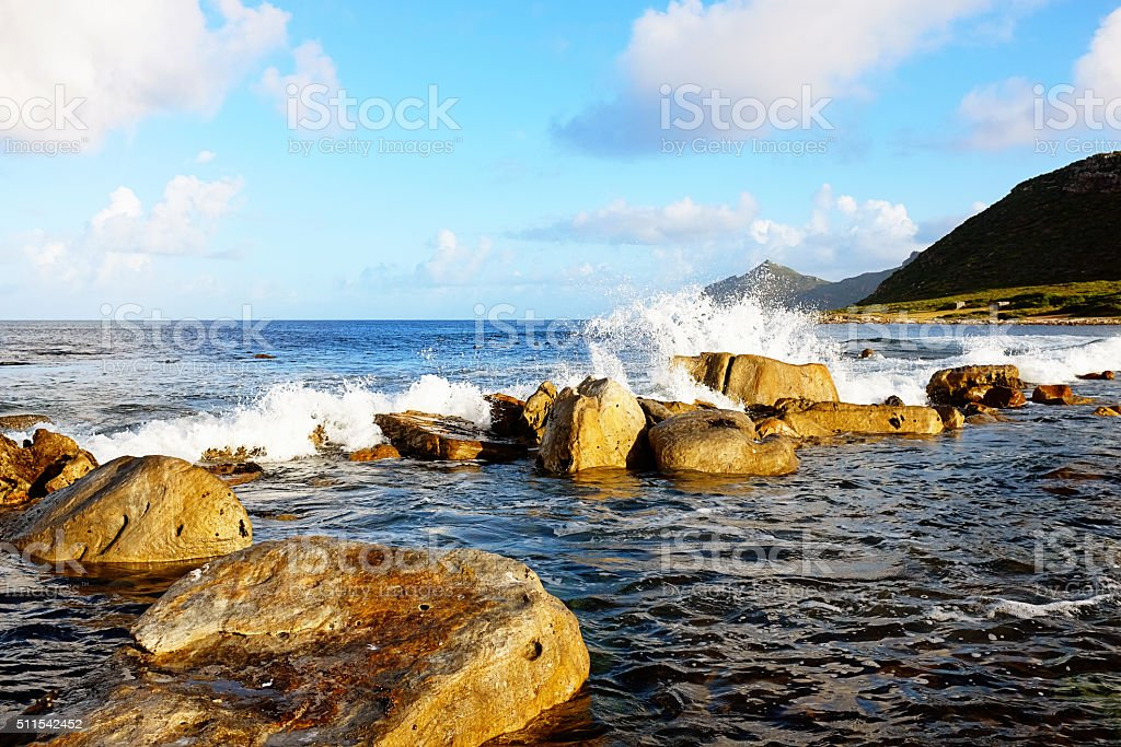 Waves breaking over rocks near Cape Point, South Africa stock photo