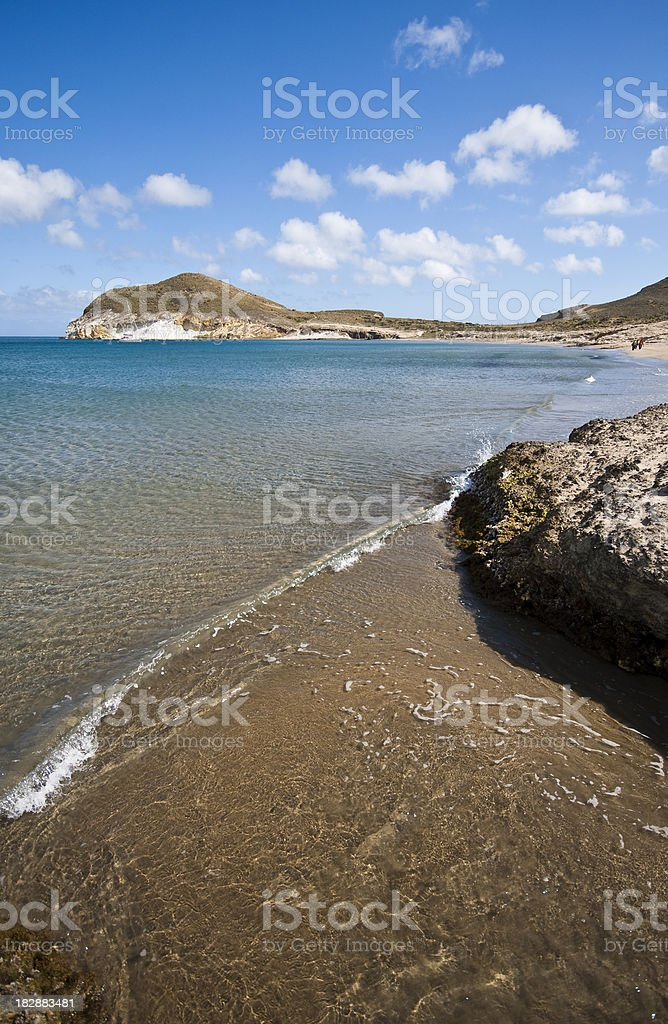 Waves come gently in at Los Genoveses Beach, Spain.  royalty-free stock photo