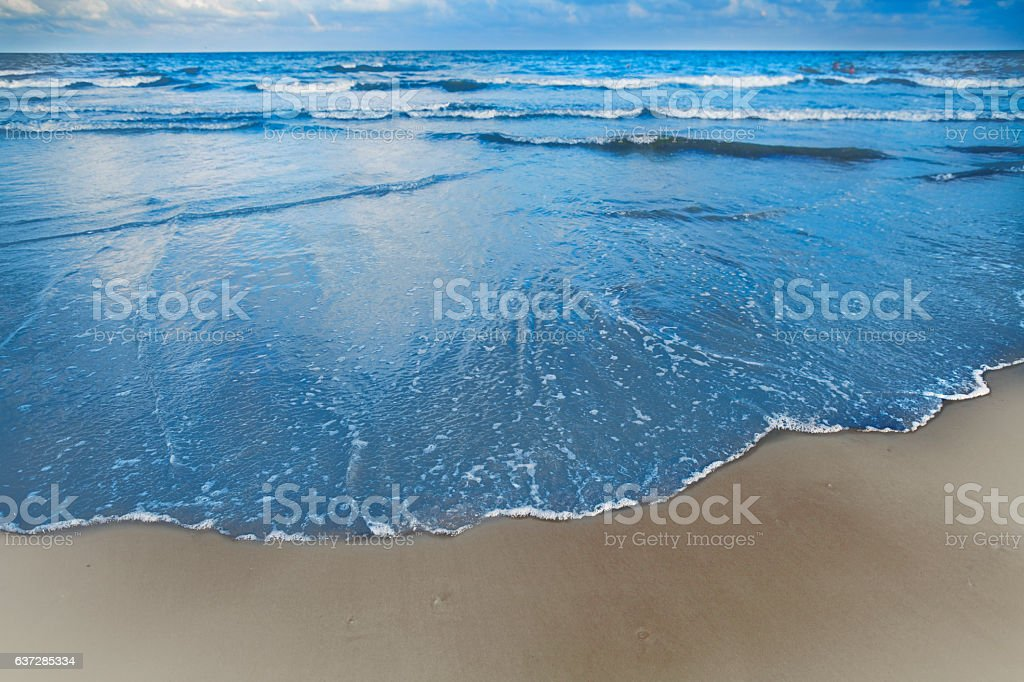 Waves coming into shore at the beach stock photo