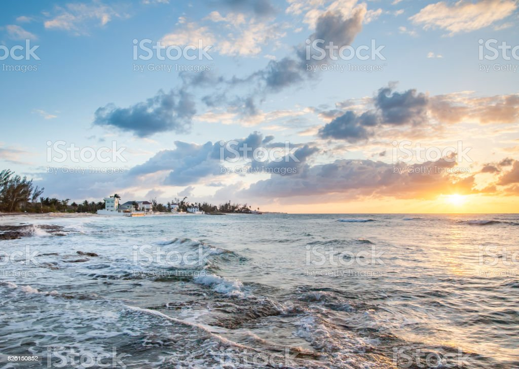 Waves cover the Shore in a Sunset scene on the Bahama Island stock photo