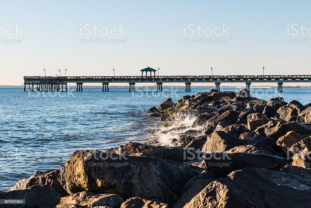 Waves Crash on Jetty at Buckroe Beach stock photo
