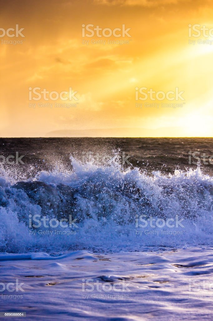 Waves Crash Onto the Beach at Hengistbury Head in a Dramatic Winter Storm stock photo