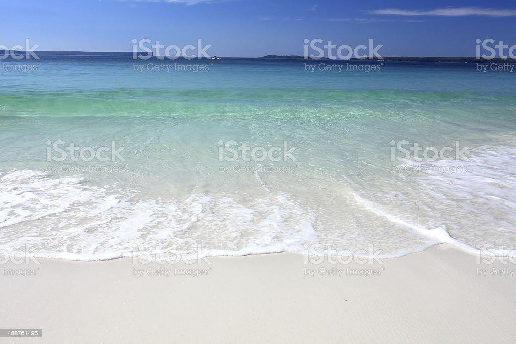 Waves crash onto the beach stock photo
