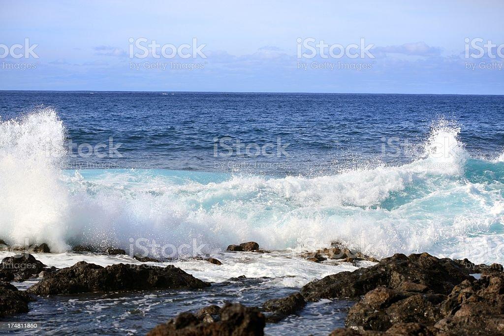 Waves crashing against rocks on a shoreline. royalty-free stock photo