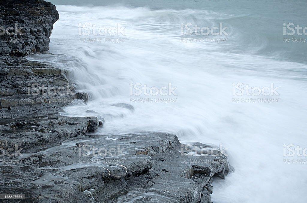 Waves crashing against the rocks royalty-free stock photo