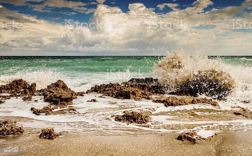 Waves Crashing Against the Rocks stock photo