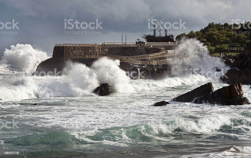 Waves crashing against the shore stock photo