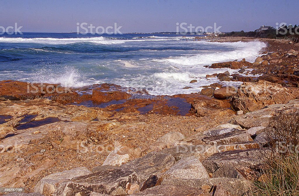 Waves crashing along rocky coast between Gloucester and Rockport Massachusetts stock photo