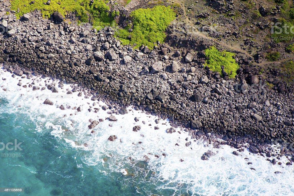 Waves crashing into lava rock formation in Kauai, Hawaii stock photo