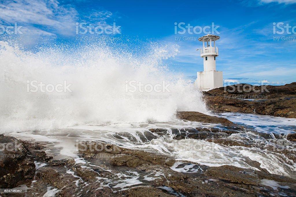 Waves crashing into lighthouse stock photo