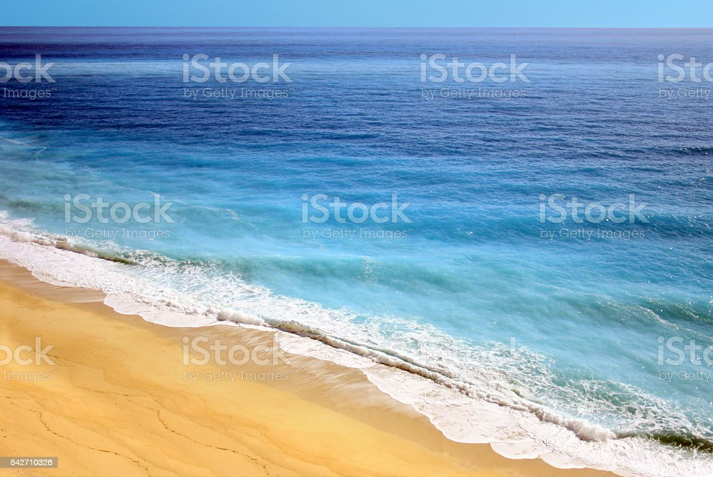 Waves Crashing on Beach Aerial View stock photo