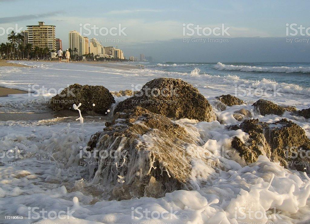Waves crashing on beach royalty-free stock photo