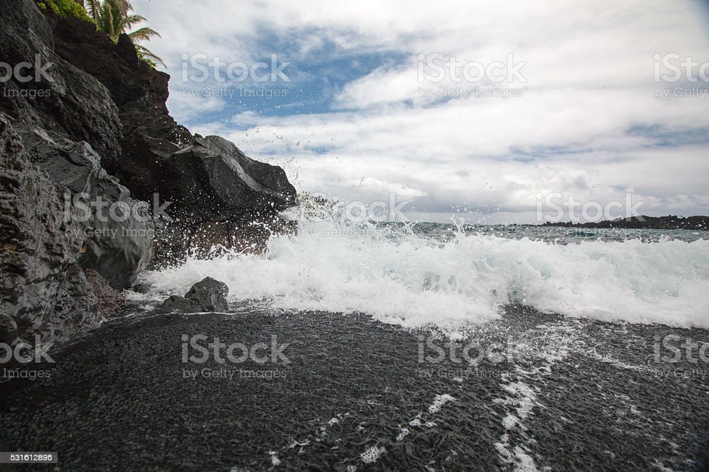 Waves Crashing on Black Sand Beach stock photo