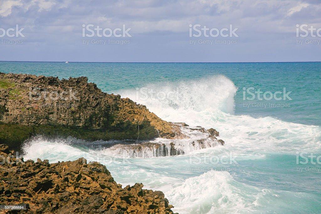 Waves Crashing on Rocks and Beach Sosua, Dominican Republic stock photo